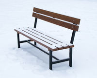 Wooden bench covered with snow - winter time Christmas Stock Image