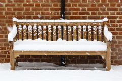 Wooden bench covered in snow stock photography