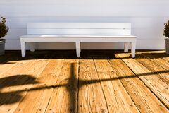 Wooden bench on deck Royalty Free Stock Images