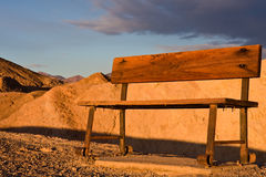 Wooden Bench in Desert. Wooden bench in bright sunlight in Death Valley National Park, California, USA royalty free stock photos