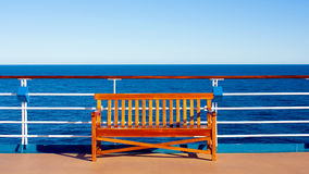 Wooden bench on desk of cruise ship Stock Photo