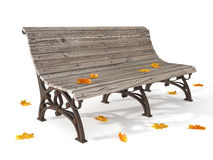 Wooden bench with dry yellow leaves Royalty Free Stock Photo