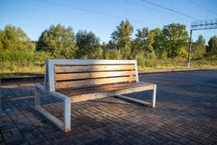 Wood and metall bench on the railstop. Wooden bench filmed on the railstop early morning royalty free stock images