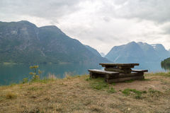 Wooden bench in fjord Royalty Free Stock Photo