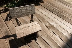 A wooden bench on the wooden floor royalty free stock photography