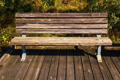 Bench on a wooden floor Stock Photography