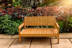 Bench in the flower garden. Wooden Bench in the flower garden Royalty Free Stock Photos