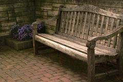 Wooden Bench and Flowers Royalty Free Stock Photography