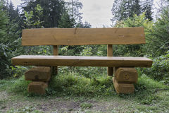 Wooden bench in forest Stock Photo