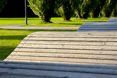 Wooden bench in the form of a wave. To stay in the park Stock Photo