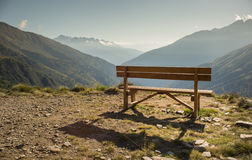 Wooden bench in front of amazing view on valley and mountains P Stock Image