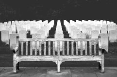 Wooden Bench in Front of Cemetery Stock Image