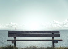 Wooden bench in front of the sea Royalty Free Stock Photography