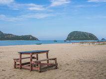 Wooden bench in front of the sea. And moutain Stock Photo