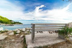 Wooden bench in front of the sea Royalty Free Stock Images
