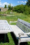 Wooden Bench in a Garden Royalty Free Stock Photo