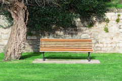 Wooden bench on a garden Stock Photo