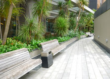 Wooden bench in the garden Royalty Free Stock Photos