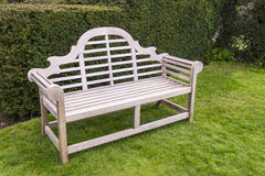 Wooden bench in a garden. Royalty Free Stock Image