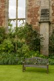 Wooden bench in garden at Bishop palace ,Wells Royalty Free Stock Photography