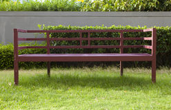 Wooden bench in garden Stock Image