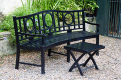 Wooden Bench in a garden. Stock Image
