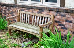 Wooden bench in the garden Royalty Free Stock Photography