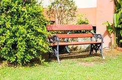 Wooden bench in garden. Stock Photos