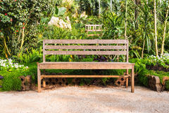 Wooden garden bench Stock Images