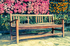 Wooden bench in garden, vintage style Royalty Free Stock Images