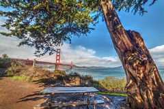 Wooden bench by Golden Gate bridge. California Royalty Free Stock Photos