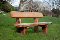 Wooden bench on grass Stock Image