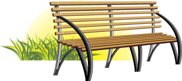 Wooden bench among a grass Royalty Free Stock Image