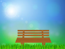 Wooden bench on grass Royalty Free Stock Photo