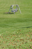 Wooden Bench in the Grass Royalty Free Stock Photo