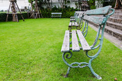 Wooden bench with grass field Royalty Free Stock Images