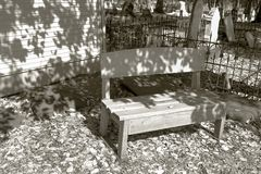 Wooden bench in graveyard Stock Photography
