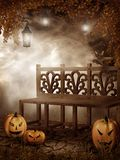 Wooden bench and Halloween pumpkins Royalty Free Stock Photography