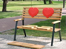 Wooden bench with hearts Stock Photo