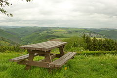 Wooden bench in the high point of the valley Royalty Free Stock Photo