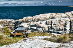 Wooden bench for hikers on the archipelag Stock Photo