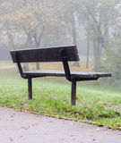 Wooden bench at hiking trail for rest and taking break Royalty Free Stock Photo