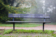 Wooden bench at hiking trail for rest and taking break Stock Images