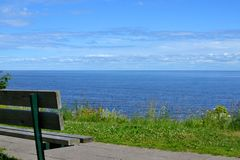 Wooden bench in Kallaste, Estonia. Wooden bench on Peipsi lake in Kallaste, Estonia Royalty Free Stock Photos