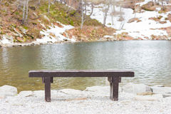 Wooden bench on the lake Royalty Free Stock Images