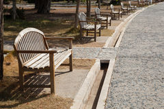 Wooden bench located near the corridor. Stock Images