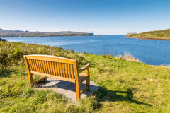 Wooden bench at Loch Harport Royalty Free Stock Photo