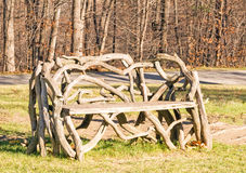 Wooden bench made of local tree branches Royalty Free Stock Images
