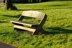 Wooden bench on the meadow Royalty Free Stock Photo