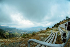 Wooden bench in the mountain valley. Wooden bench in cyprus mountain valley Stock Image